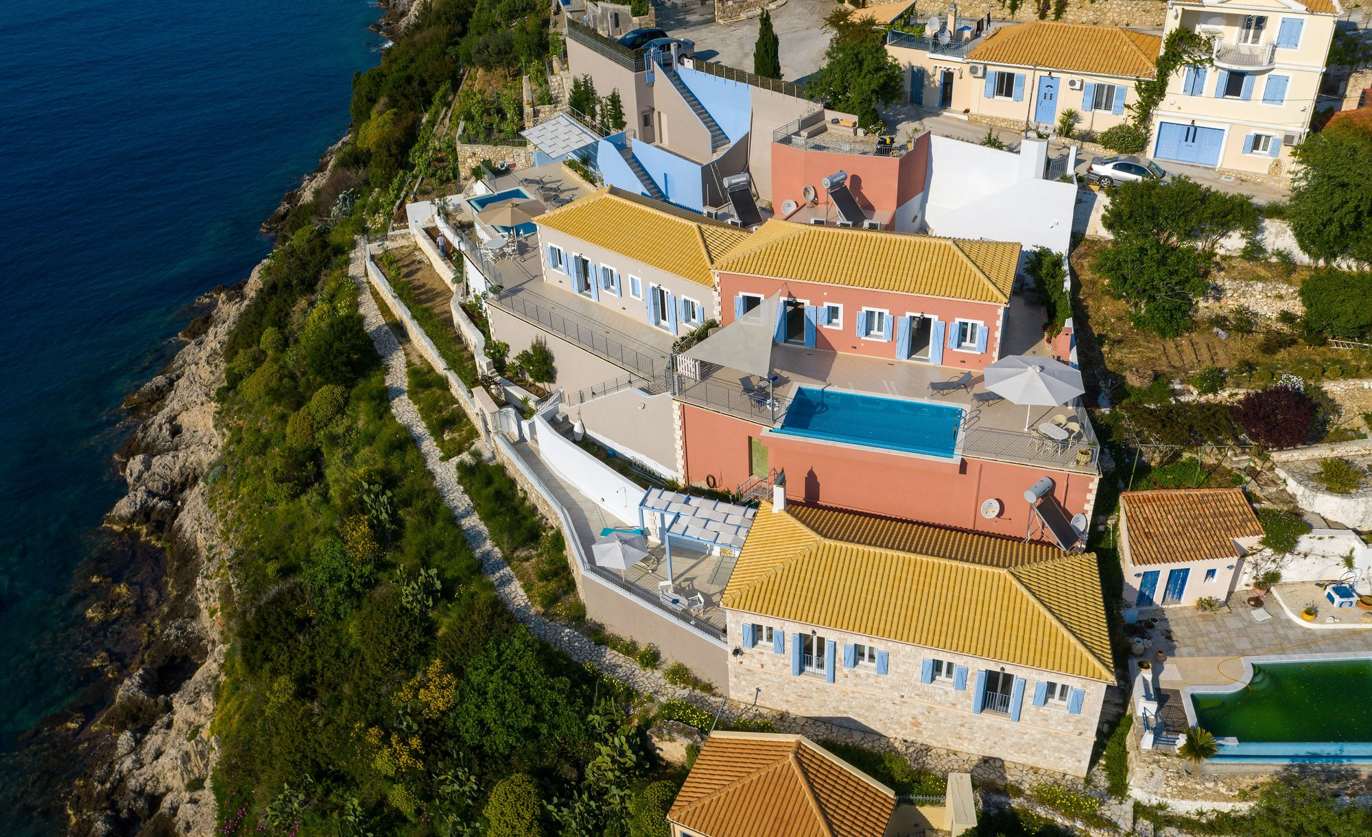 Astakos is the property with a yellow roof in the front